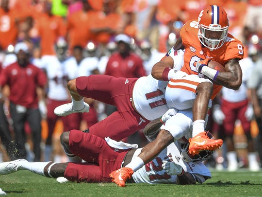 Clemson running back Wayne Gallman (9) is brought down by Troy defensive end Uvakeious McGhee (11) on Saturday, September 10, 2016 at Clemson's Memorial Stadium.