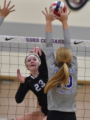 McQueen's Annika Kerns goes to block a shot by Spanish Springs' Emily Moore in Tuesday's game at Spanish Springs.