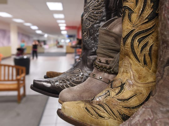 Cowboy boots are on display outside of the Buckle store at the Foothills Mall redevelopment in 2014.