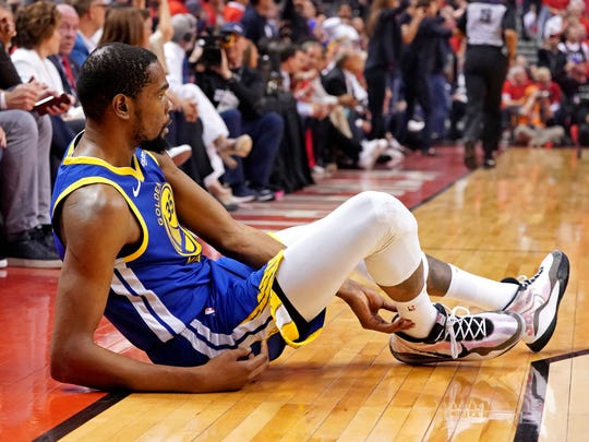 Jun 10, 2019; Toronto, Ontario, CAN; Golden State Warriors forward Kevin Durant (35) sits on the court after an apparent injury during the second quarter in game five against the Toronto Raptors of the 2019 NBA Finals at Scotiabank Arena. Mandatory Credit: Kyle Terada-USA TODAY Sports