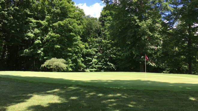 The par 4, No. 7 green emerging from the shadows at The Pines.