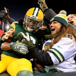 Green Bay Packers wide receiver Randall Cobb (18) Lambeau leap after catching  touchdown pass in the second quarter.