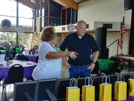 Leanne Mahoney and Rob Puchacz organize the raffle for Casino in the Cape on Feb. 16 at Cape Coral Yacht Club.