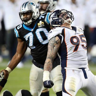 Denver Broncos defensive end Derek Wolfe (95) reacts