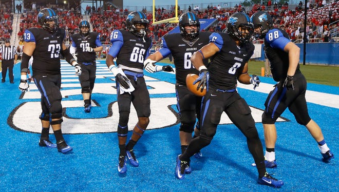 MTSU running back Jordan Parker (6) celebrates after scoring a touchdown against Western Kentucky on a 7-yard run in the first quarter on Saturday, Sept. 13, 2014 at Floyd Stadium in Murfreesboro.