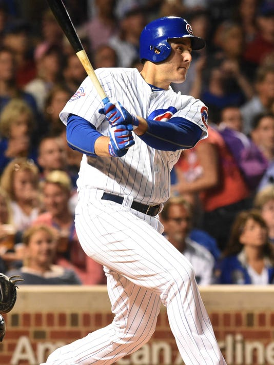 Chicago Cubs' Anthony Rizzo hits a first-inning single against the Milwaukee Brewers in a baseball game Thursday, Sept. 15, 2016, in Chicago. The Brewers won 5-4. (Joe Lewnard/Daily Herald via AP)