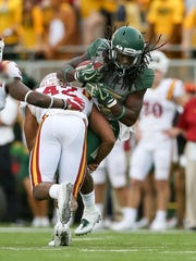 Baylor Bears running back JaMycal Hasty (33) is hit by Iowa State Cyclones linebacker Marcel Spears Jr. (42) at McLane Stadium.