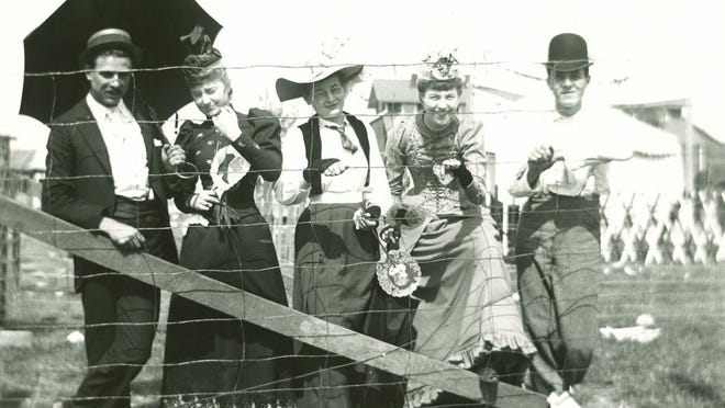 A group of people who attended the Lenawee County Fair early in the 20th century, pose for a photo-op. The early fairs were held in October when the weather was much cooler than today's late summer fairs.