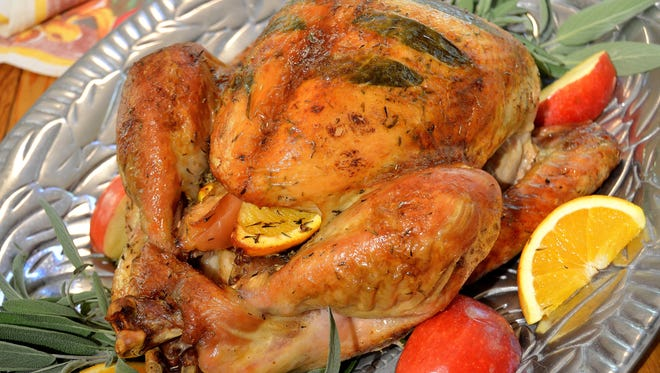 Herb butter under and over the skin, and oranges and apples in the cavity, will make for an aromatic, impressive first-time Thanksgiving turkey.