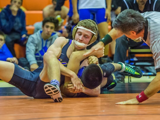 Kirtland Central's Aidan Cockrell pins Bloomfield's Diego O'Neill during the Aztec Tiger Duals on Jan. 23 in Aztec.