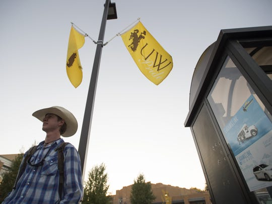 Wyoming student Zach Shannon waits for a shuttle on campus in Laramie Wednesday, September 28, 2016.