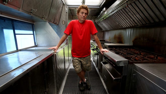 Kurt Peters of Holly, Michigan inside his large catering truck where he and those who worked for him would cook and serve food to hundreds of people on movie sets in Michigan.