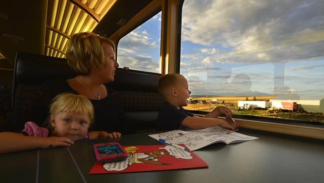 Jessica DeWild and her two children Adaline, 2, and Keith, 4, enjoy their ride on the BNSF Special military appreciation train ride on Wednesday evening.