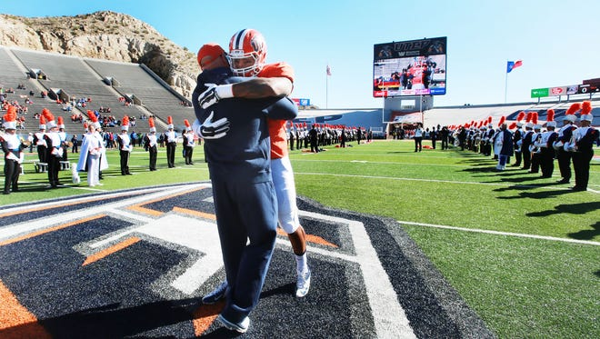 UTEP senior Roy Robertson-Harris embraced coach Sean Kugler after he was introduced with other seniors Saturday. The team's final season game in Saturday at North Texas.