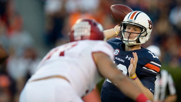 Auburn quarterback Sean White (13) throws a pass during