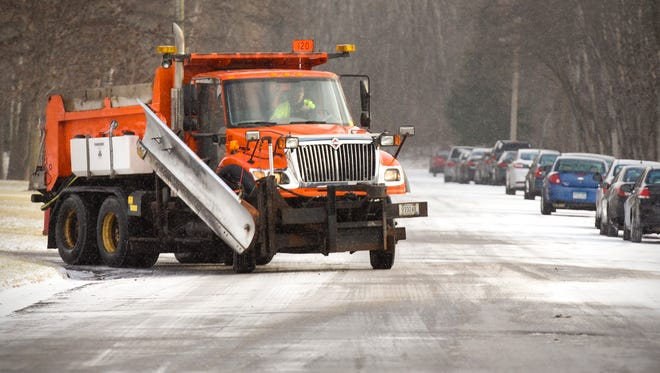 St. Cloud City snowplows were out salting intersections  Tuesday, Dec. 5, after freezing rain and snow. The city approved a dump truck and plow equipment for public works department in the 2018 budget.