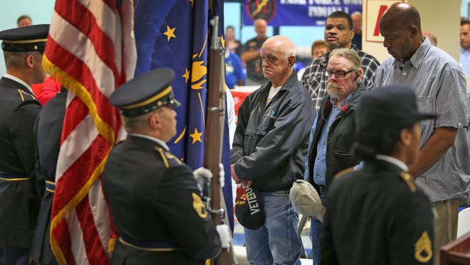 Veterans and others stand for the posting of colors at the AMVETS Post 99, Indianapolis, on Sept. 11, 2014, as part of the Hoosier Veterans Assistance Foundation of Indiana's 10th annual Veterans Stand Down program.