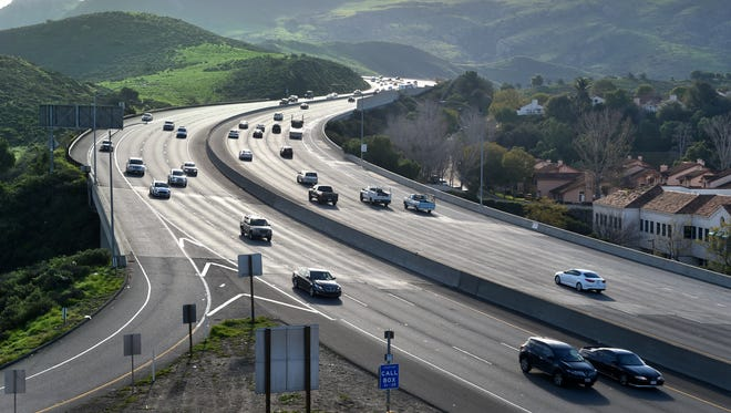 Morning traffic moves near the base of the Conejo Grade on Highway 101 near Camarillo in Ventura County. Emissions from motor vehicles account for a large portion of the air pollution in the county, according to the Ventura County Air Pollution Control District.    FILE PHOTO/THE STAR