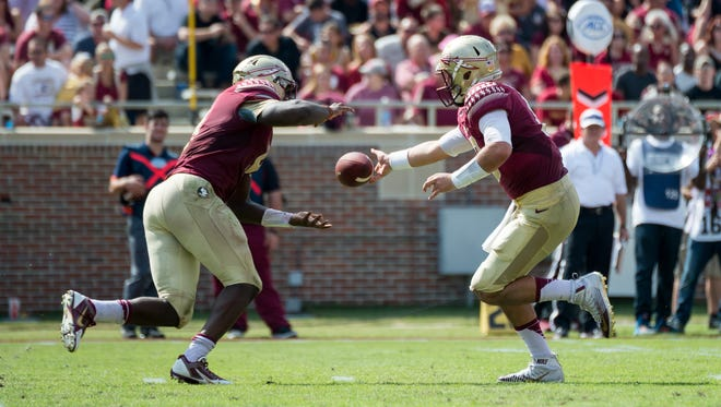 Sean Maguire hands the ball off to Jacques Patrick. Patrick ran for 162 yards and two touchdowns in his first start as a Seminole.