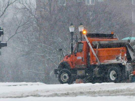 Look For Flashing Green Lights On Snowplow Trucks