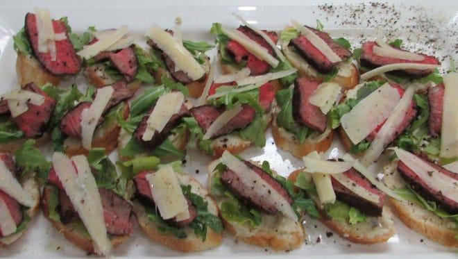 Filet of Beef, Arugula & Artichoke Crostini