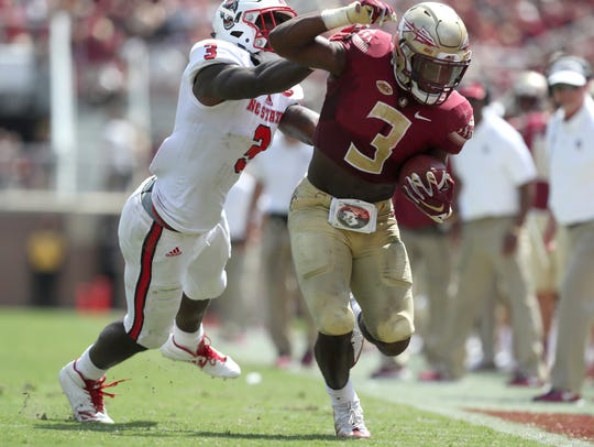 FSU's Cam Akers is pushed out of bounds near the goal