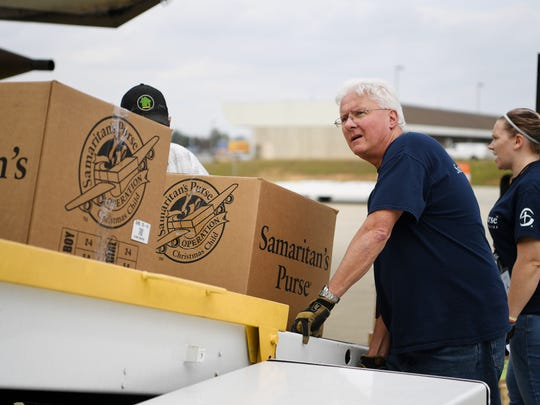 Tony Burke helps load Operation Christmas Child boxes onto a Samaritan's Purse airplane at Piedmont Triad International Airport in Greensboro, North Carolina, November 6, 2017.
