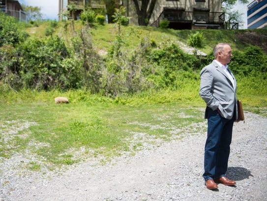 Rick Blackburn stands on the future site of a 19-story