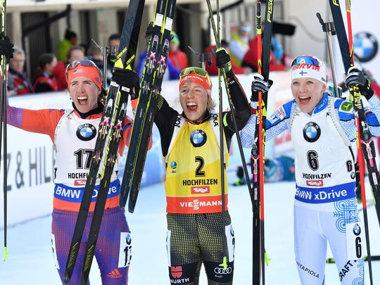 Germany's winner Laura Dahlmeier, center, America's second placed Susan Dunklee, left, and Finland's third placed Kaisa Makarainen celebrate in the finish area after the women's 12,5 km mass start competition at the Biathlon World Championships in Hochfilzen, Austrian province of Tyrol , Austria, Sunday, Feb. 19, 2017.