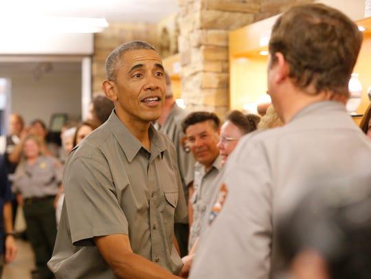 President Barack Obama thanks members of the National