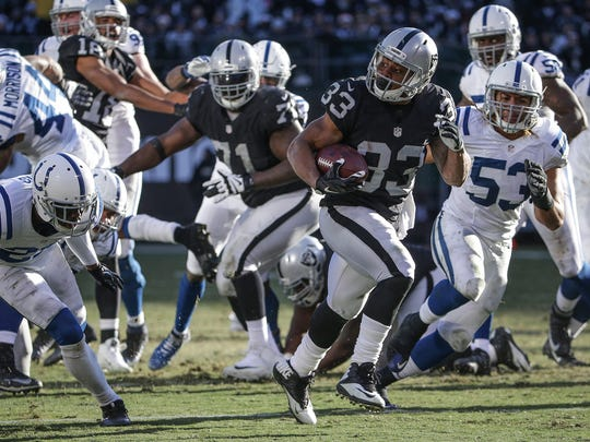 Oakland Raiders running back DeAndre Washington (33) breaks off a touchdown run against the Indianapolis Colts at Oakland Alameda Coliseum in Oakland, Calif., on Saturday, Dec. 24, 2016.