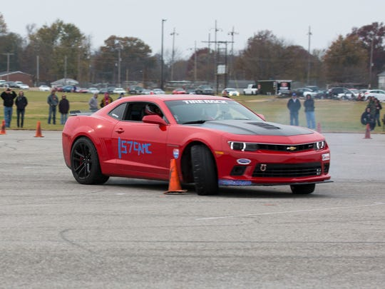 Jacob Whitson's red Camaro spins as he take a turn to fast and hits a cone during his run at the autocross race at Roberts Park on Saturday afternoon.