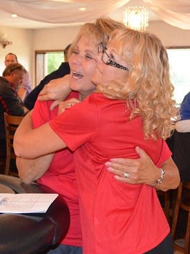 Grand prize raffle winner Terri Gibbons, at left, is congratulated by Vicky Brost, annual event chairperson.