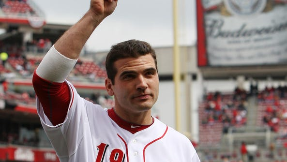 Cincinnati Reds first baseman Joey Votto (19) tips