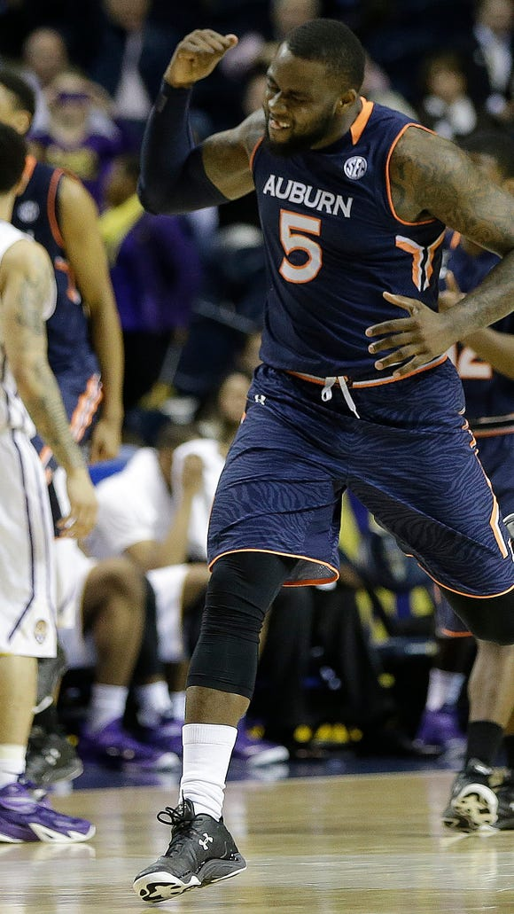 Auburn forward Cinmeon Bowers (5) celebrates a clock violation against LSU during the second half of an NCAA college basketball game in the quarterfinal round of the Southeastern Conference tournament, Friday, March 13, 2015, in Nashville, Tenn. (AP Photo/Mark Humphrey)