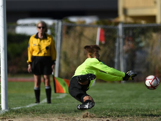 Wooster's Max Barainca makes a diving save on a penalty kick while taking on North Valleys during their soccer game in Reno on Sept. 21, 2016.