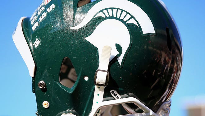 Players from Michigan State are expected to wear black silicone wristbands bearing the words 'All Players United' today against Minnesota.