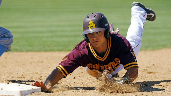 Arizona State's Jordan Aboites (23) dives safely back to first in the 8th inning of their win over UCLA Sunday, May 10,  2015 in Tempe, Ariz.