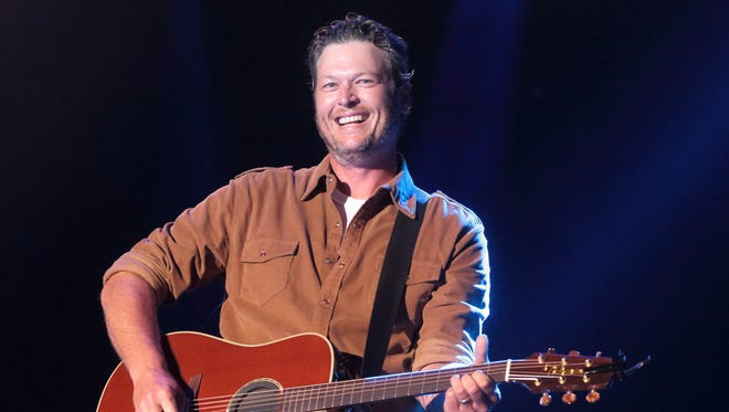 In this June 26, 2015 photo, singer-songwriter Blake Shelton performs on Day 1 of the 2015 Big Barrel Country Music Festival at The Woodlands in Dover, Del. Shelton sued In Touch Weekly and its parent company Bauer Publishing Co. on Monday, Oct. 19, 2015, for defamation over a September cover story claiming the country music star was drinking heavily, it contributed tohis divorce from Miranda Lambert and hewas headed to rehab.