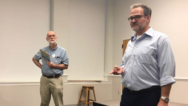 Erik Curren, a member of the Staunton City Council, talks about a potential economic solution to climate change at a meeting at the Staunton Public Library on Tuesday, July 25, 2017.