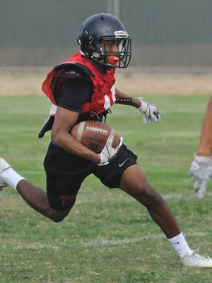 Rio Mesa's Donte Martin returns a kickoff during practice. Martin is one of the top cornerbacks in the county and is part of a deep and talented Spartans team. Rio Mesa opens the season Friday night at home against Camarillo.