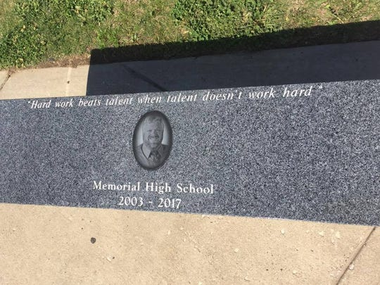 A memorial bench donated in honor of late Reitz Memorial Coach Dylan Barnes was dedicated Monday, May 15, 2017. The bench is engraved with Barnes' portrait and motto on the top.