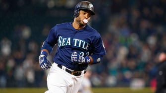 Seattle Mariners second baseman Robinson Cano (22) runs the bases after hitting a two-run homer against the Oakland Athletics.
