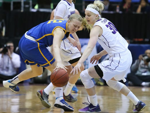 Delaware forward Hannah Jardine (left) loses the ball as she gets pressure from Nikki Newman (right).  Number two seed Delaware take on top seed James Madison in the final of the CAA Championship at the Show Place Arena in Upper Marlboro, Md. Sunday, March 16, 2014.