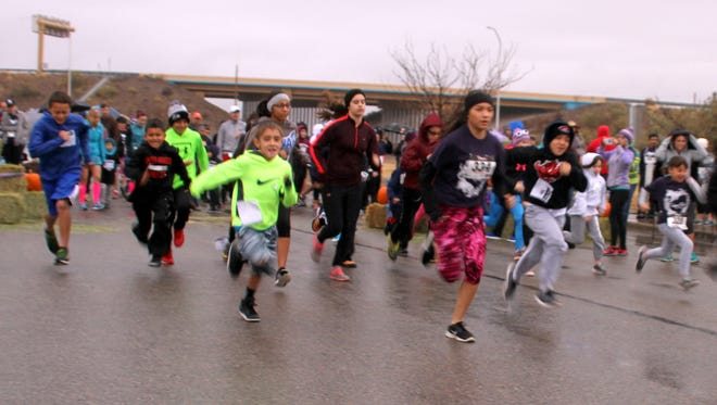 The 13th annual Turkey Trot will go down as the soggiest following a steady rain that pelted runners and walkers on Thanksgiving Day at Voiers Park. The children took to the starting gun and made a quick one-mile dash. Jaclyn Ley, a Deming native who now living in Albuquerque, was the first female across the finish line in the adult 3-mile run. Her winning time was 20:05. Jeffrey Sandoval, a 2015 graduate of Deming High School and former Wildcat cross country runner, was the first male finisher in a time of 19:43. The Turkey Trot is sponsored by Ultimate Fitness and Summit Healthcare in Deming. The Trot raised $6,500 that was donated to the Healing House, Luna County's shelter for survivors of domestic violence.