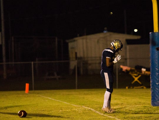 Gus Antoine Jr., 1, stands behind the touchdown zone