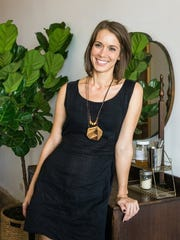 Jessica Gignac poses at her coffee shop, Eleanor's