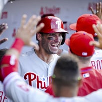 Phillies right fielder Jeff Francoeur celebrates in the dugout after hitting a home run during a win over the Cubs on Friday.