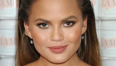 One of her many charms? Chrissy Teigen knows how to