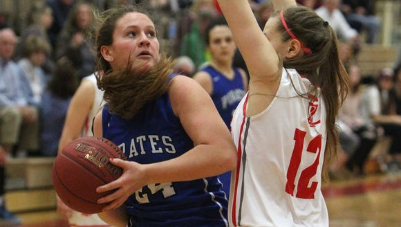 Pearl River's Ashley Rilley is guarded by Tappan Zee's Ashley Chaluisan during their game at Tappan Zee Jan. 11, 2018.